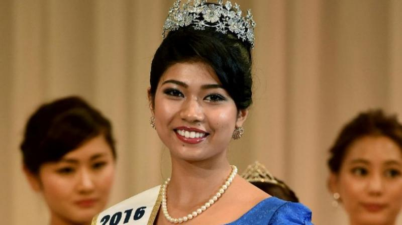 Priyanka Yoshikawa smiles as she holds the trophy after winning the Miss Japan title at the Miss World Japan 2016 Beauty Pageant in Tokyo on September 5, 2016. (Photo: AFP)