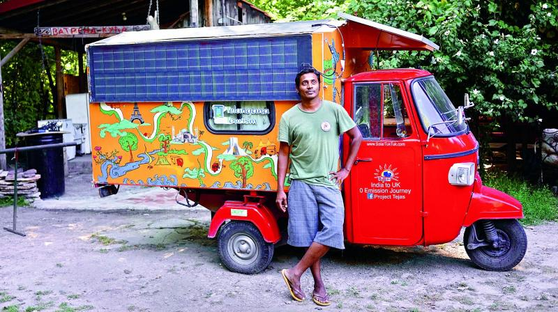 Naveen Rabelli poses with his tuk-tuk during an event in Belgrade, Serbia.
