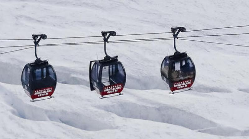 Tourists stuck in French Alps cable cars saved