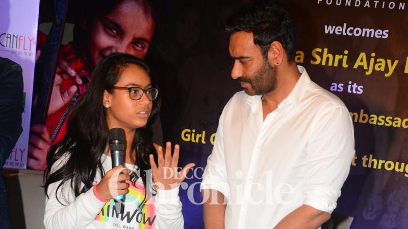 Ajay Devgn, along with daughter Nysa, launched the She Can Fly campaign by Smile foundation. (Pic: Viral Bhayani)