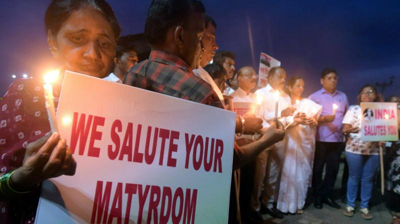 Congress party workers in Mumbai pay tribute on Monday to the soldiers who were killed in the terrorist attack at Uri Army camp on Sunday. (Photo: PTI)