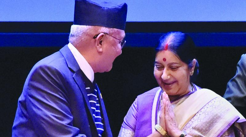 Nepal Prime Minister K.P. Sharma Oli and external affairs minister Sushma Swaraj at the 21st Sapru House Lecture, organised by the Indian Council of World Affairs, in New Delhi on Monday. (Photo: PTI)