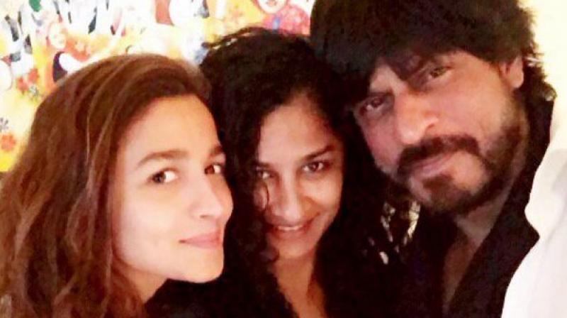 Shah Rukh Khan with film's director Gauri Shinde and co-star Alia Bhatt.