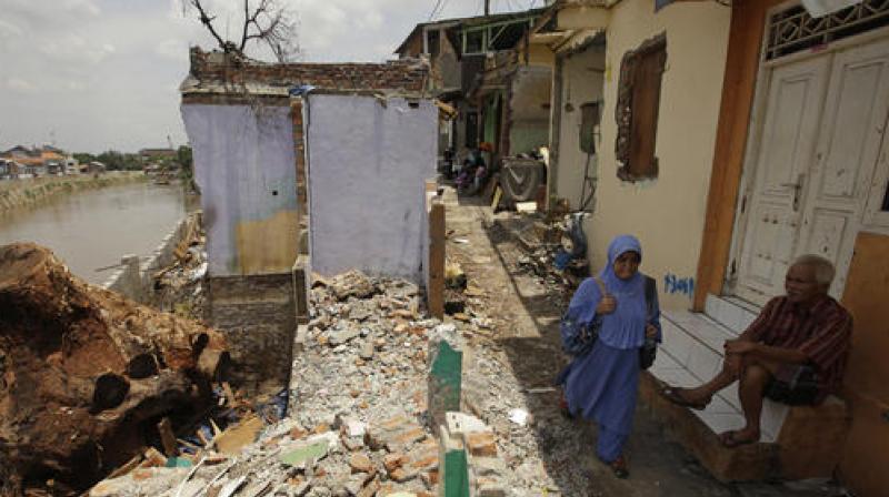 Floods and landslides kill 19 in Indonesia landslides