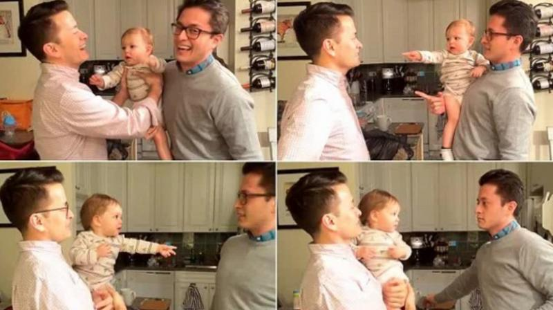 Adorable baby gets confused by his dad's twin brother