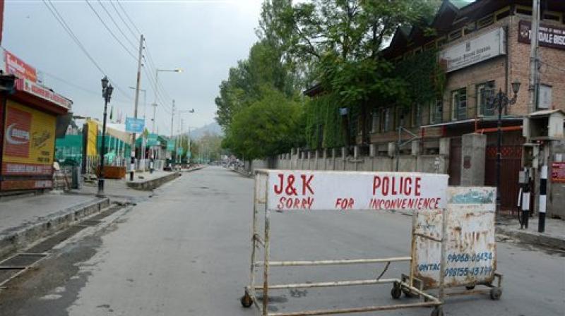 Curfew lifted, clashes begin in Kashmir