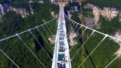 The world's highest and longest glass-bottomed bridge opened on Sunday in China's spectacular Zhangjiajie mountains -- the inspiration for American blockbuster Avatar. (Photo: AP)