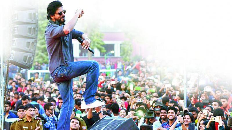 Shah Rukh Khan with his fans at a promotional event.