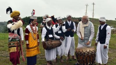 Prime Minister Narendra Modi has always tried to imbibe the culture and tradition of the places he visits. On similar lines when the Prime Minister visited Meghalaya he tried his hand at playing drums along with folk dancers at a cultural event organised in his honour at Mawphlang Village, 25 km from Shillong, in East Khasi hills district of Meghalaya on Saturday morning. (Twitter)