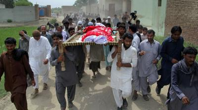 Pakistan's controversial model Qandeel Baloch was strangled to death afer being drugged by her younger brother Wasim in Multan city. Relatives and local residents carry the coffin of slain model Qandeel Baloch for funeral prayers in Shah Sadar Din village, near Dera Ghazi Khan, Pakistan.