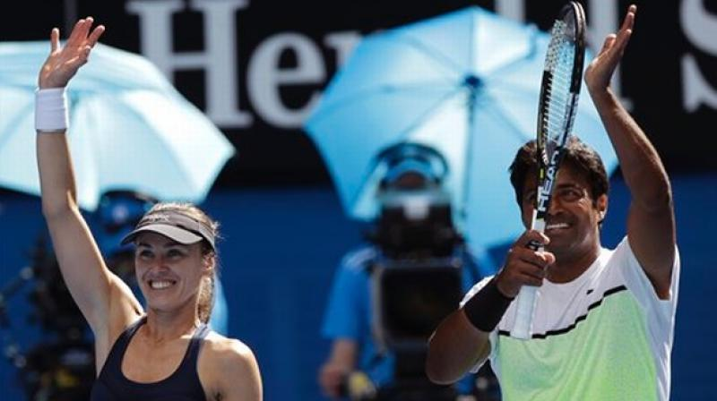 Defending champions in mixed doubles, Paes and Swiss Martina Hingis prevailed over USA's Sachia Vickery and Frances Tiafoe 6-3, 6-2 in just 51 minutes.(Photo: AP)
