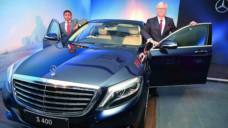 Mercedes benz puts investments on hold after supreme court ban for Mercedes benz ceo