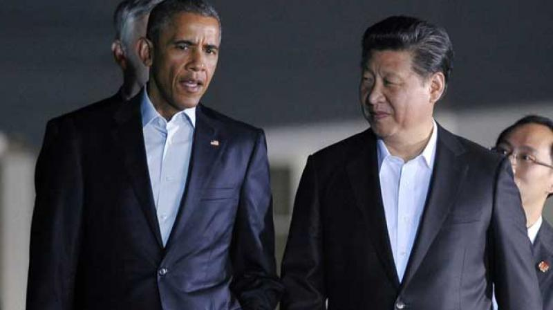 Obama and China's Xi Jinping are meeting at the opening of the two-week Paris conference to underscore the need for all nations to come together on a strong agreement to combat climate change. (Photo: AFP)