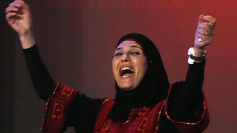 Hanan Al Hroub beat India's Robin Chaurasiya, who runs a not-for-profit school in Mumbai for girls from the city's red light district of Kamatipura, and eight other finalists to bag the Varkey Foundation's prize at the star-studded ceremony on Sunday night. (Photo: AP)
