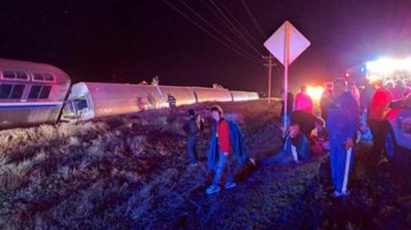 Passengers gather after a train derailed near Dodge City, Kan., Monday, March 14, 2016. An Amtrak statement says the train was traveling from Los Angeles to Chicago early Monday when it derailed just after midnight. (Photo: AP)