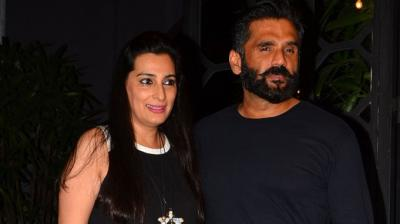 Suniel Shetty bonded with his son Aahan, wife Mana and relatives at a plush eatery in the city. Photo: Viral Bhayani