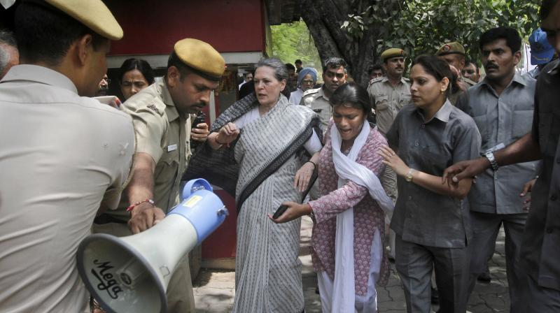 "A combative Sonia Gandhi on Friday attacked the Modi government for ""murdering"" democracy and unleashing a campaign of ""baseless allegations"" against the opposition, as top Congress leaders hit the streets and courted arrest near Parliament."