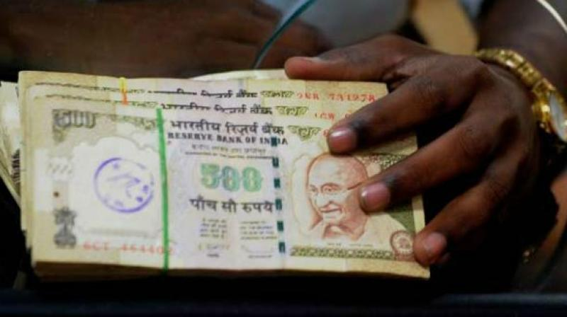 Rupee soars to 2-week high on shaky dollar, easing CAD