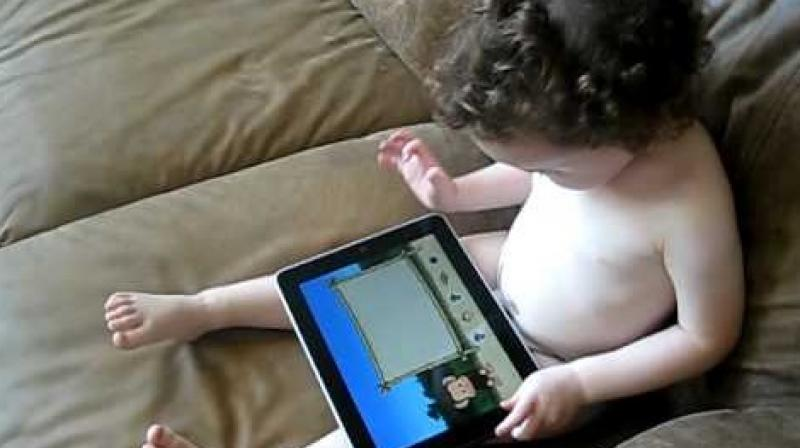 The American Academy of Pediatrics, however, advises that children should not be exposed to any screens, including touch screens, before the age of two. (Credit: YouTube)