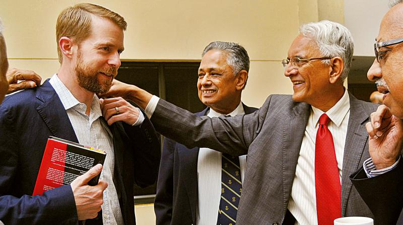 Former India Ambassador to Russia P.S. Raghavan (right) with Toby Dalton, the author of the book Not War, Not Peace?  and R ear Admiral R. Ganesh, in Bengaluru on Wednesday (Photo: DC)