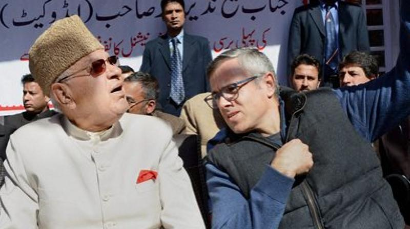 With his father Farooq Abdullah at the first death Anniversary of his uncle and National Conference General Secratary Sheikh Nazir Ahmad. (Photo: PTI)