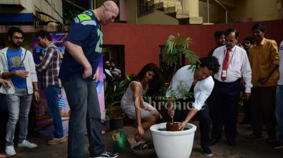 While promoting their film 'A Flying Jatt', Tiger Shroff, Jacqueline Fernandez and Nathan Jones planted a sapling. They also showed their concern to have a clean environment by sweeping the road. (Photo: Viral Bhayani)