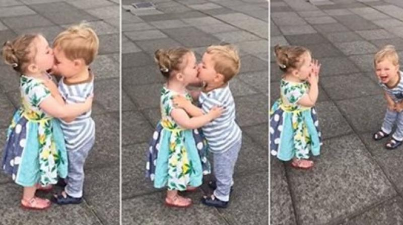 Adorable video of babies kissing and laughing will make