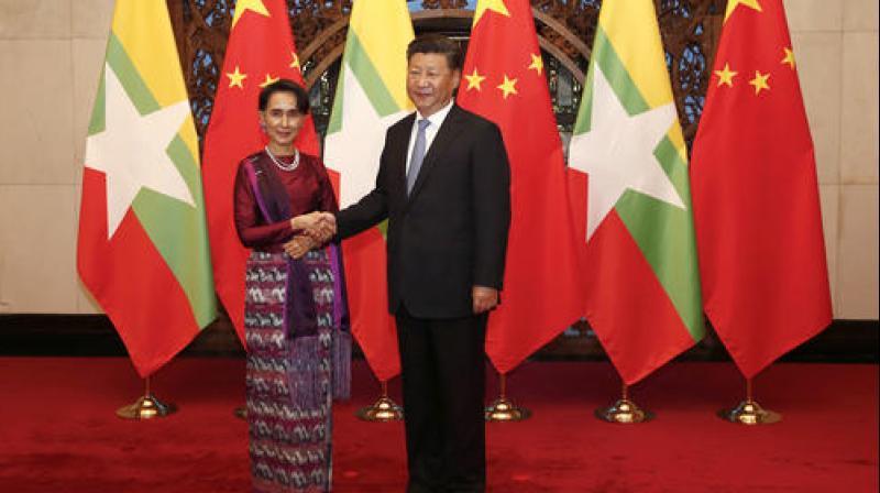 china-myanmar-vow-closer-ties-after-suu-kyi-visits-beijing