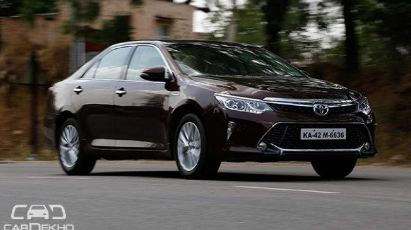 toyota slashes prices of camry hybrid. Black Bedroom Furniture Sets. Home Design Ideas