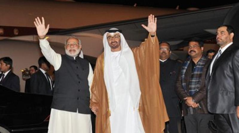 Narendra Modi shook hands and exchanged pleasantries with visitng Abu Dhabi prince at Palam Air Force station. (Photo: PTI)