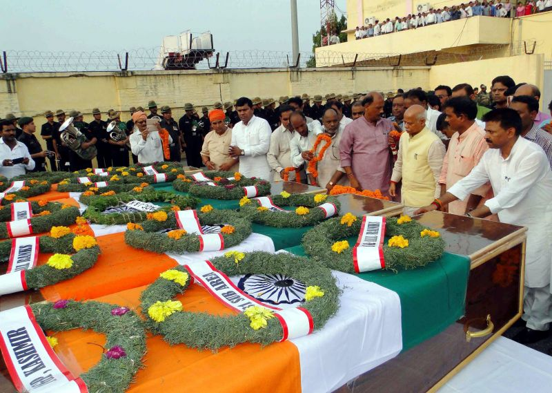 People at Babatpur Airport paying homage to seven army soldiers who were killed in the Uri attack