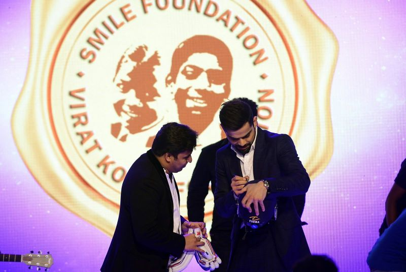 Virat Kohli was busy signing cricket memorabilia which was auctioned during the event.