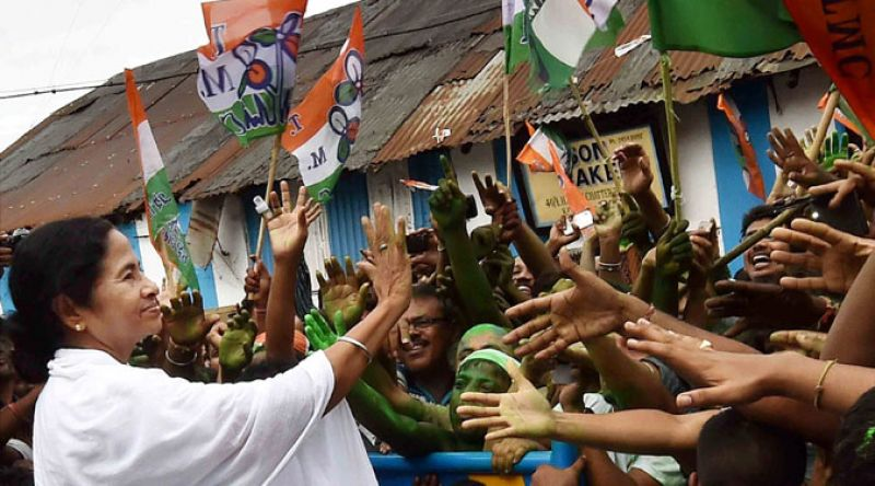 West Bengal Chief Minister Mamata Banerjee greets supporters after her party's thumping win in the Assembly polls, in Kolkata on Thursday. (Photo: PTI)