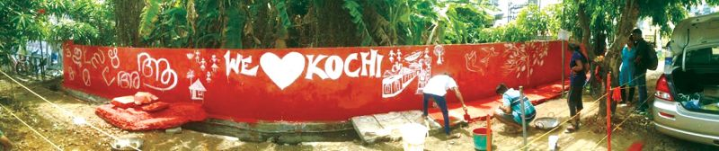 Volunteers of Redraw Kochi painting graffiti