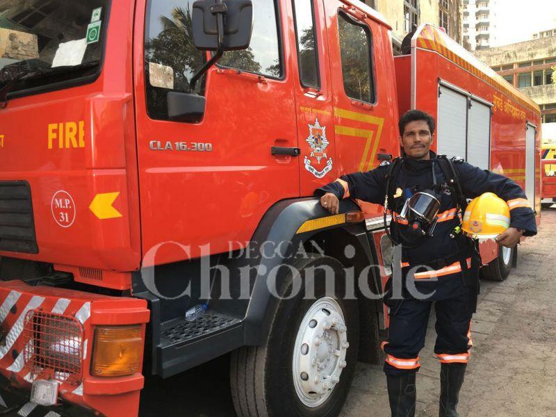 Randeep Hooda poses besides a fire truck.
