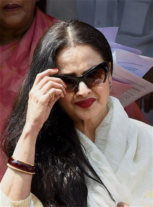 Clad in a cream coloured saree and wearing goggles, Rekha witnessed the proceedings during Question Hour. (Photo: PTI)