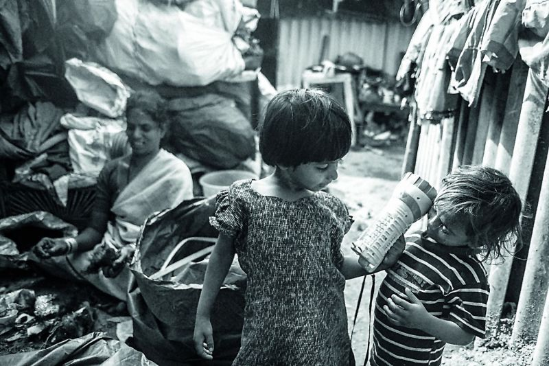 Tough life: Children as young as six years are taken along to forage through the garbage.