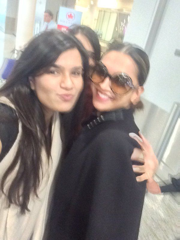 Deepika Padukone poses with her fans for a selfie at the Toronto airport