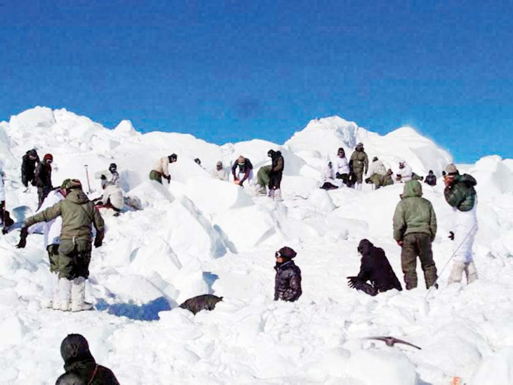 Rescue teams carry out a search operation for the soldiers buried by an avalanche, in Siachen on Tuesday (Photo: PTI)