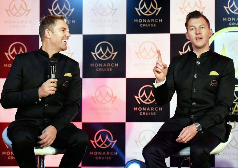 Shane Warne and Brett Lee snapped during a candid moment during the event. (Photo: PTI)