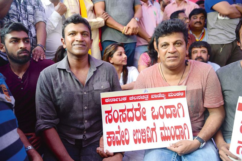 Actors Puneeth Rajkumar and Shivrajkumar at a protest meet against release of Cauvery water to  TN, in Bengaluru on Friday. (Photo: DC)