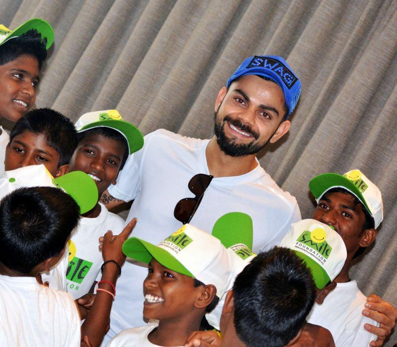 Virat Kohli sharing a smile with the Smile Foundation kids. (Photo: DC)