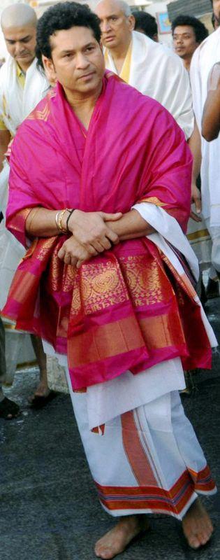 After worship, Tendulkar was presented with a sacred silk cloth, holy water and laddu prasadams. (Photo: PTI)