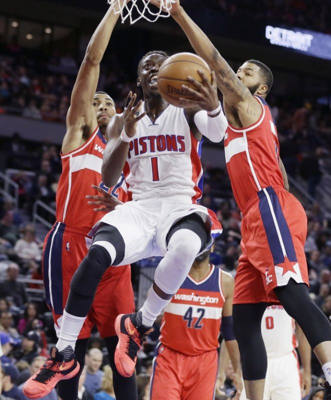 Detroit Pistons guard Reggie Jackson makes a layup while defended by Washington Wizards forwards Otto Porter Jr. and Markieff Morris during the first half of an NBA basketball game. (Photo: AP)