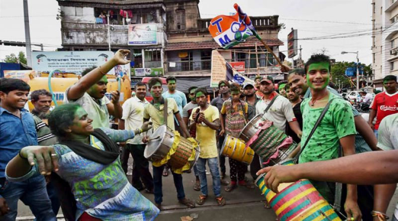 Trinamool Congress supporters celebrate the party's thumping victory in West Bengal Assembly elections in Kolkata on Thursday. (Photo: PTI)