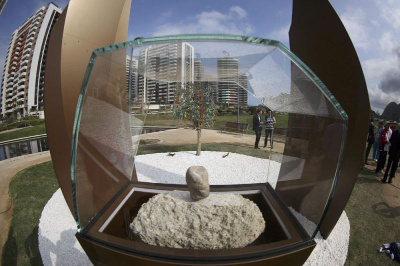 IOC president Thomas Bach inaugurated the Place of Mourning, which will now be a feature at every Olympics, with two stones from ancient Olympia encased in glass in a leafy part of the athletes' village. (Photo: AP)