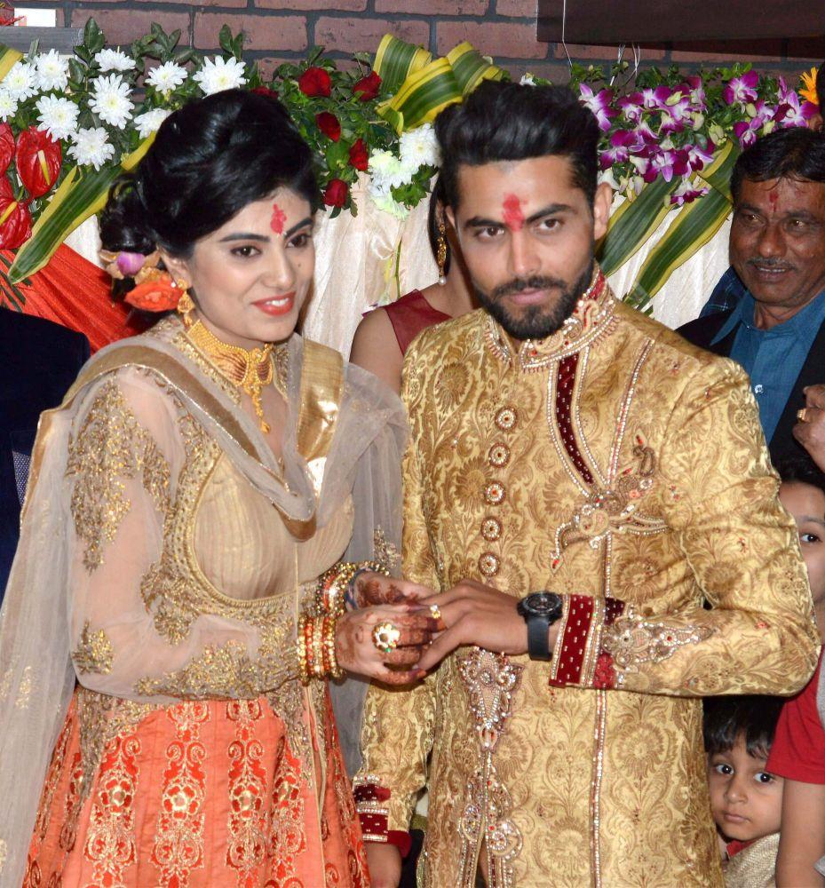 Ravindra Jadeja, Riva Solanki pose for cameras. (Photo: PTI)