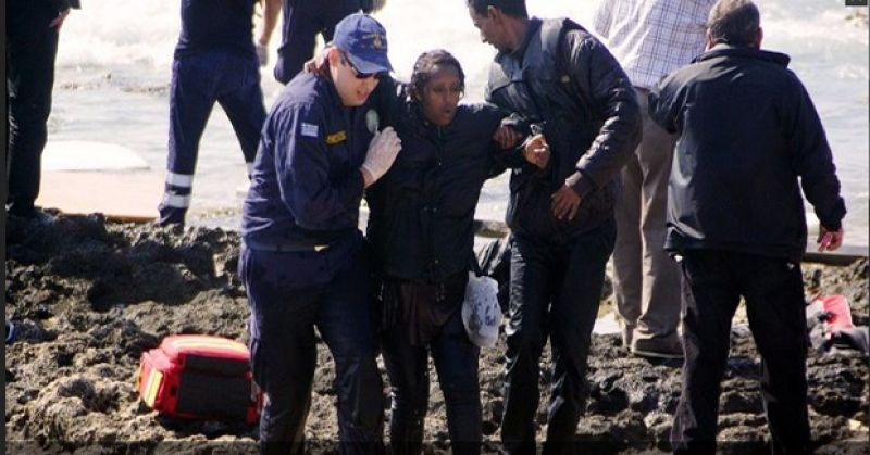 Greek coast guards help a migrant woman rescued after a boat carrying migrants sank off the island of Rhodes, southeastern Greece (Photo: AFP)
