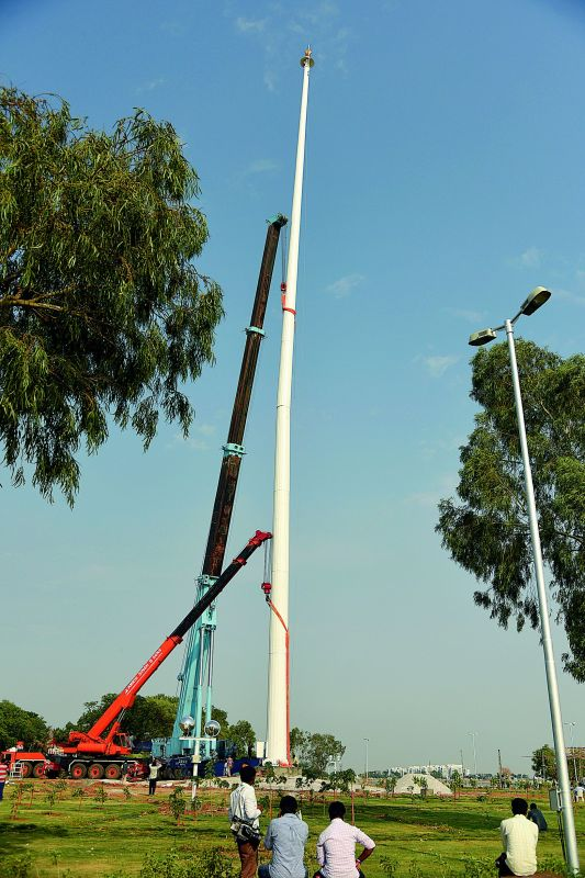 The second tallest flagpole being erected at  Sanjeen-vaiah Park