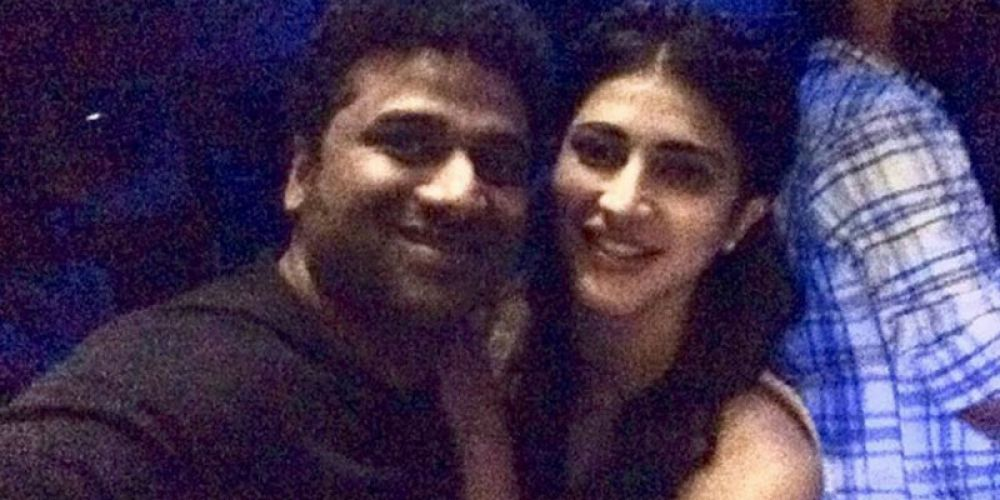The birthday girl poses with Devi Sri Prasad for a selfie at the bash.